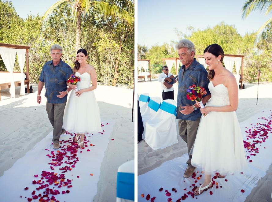 father walking bride down the aisle beach