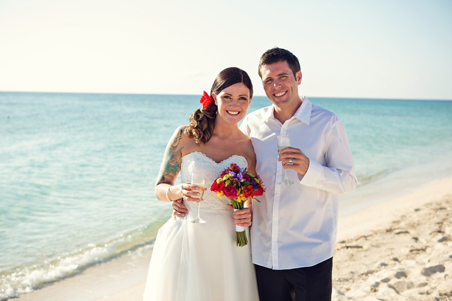 newlyweds celebrate on the beach